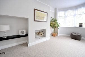 A thick white living room carpet.