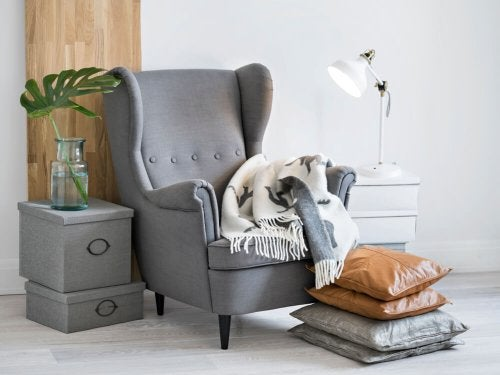 A gray armchair in a space for reading or relaxing.