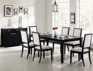 Dark chairs in a grayscale dining room.