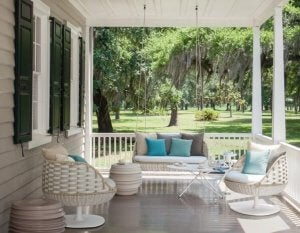 An American-style porch with columns and chairs.