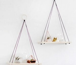 Two hanging shelves with accessories on them for diy decoration