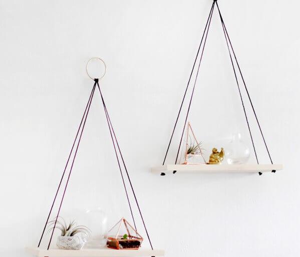 Hanging shelves against plain white walls.