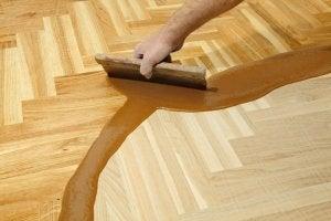 Re-finishing a wood floor.