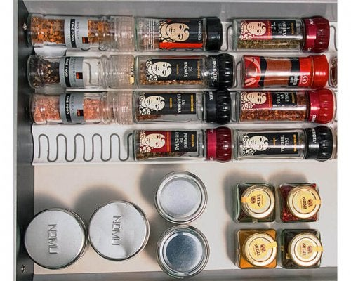 A way to store spices inside a drawer.