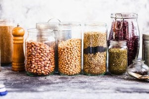 Transparent jars and containers holding various types of beans.