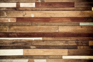 A hardwood floor with streaks and scuffs.