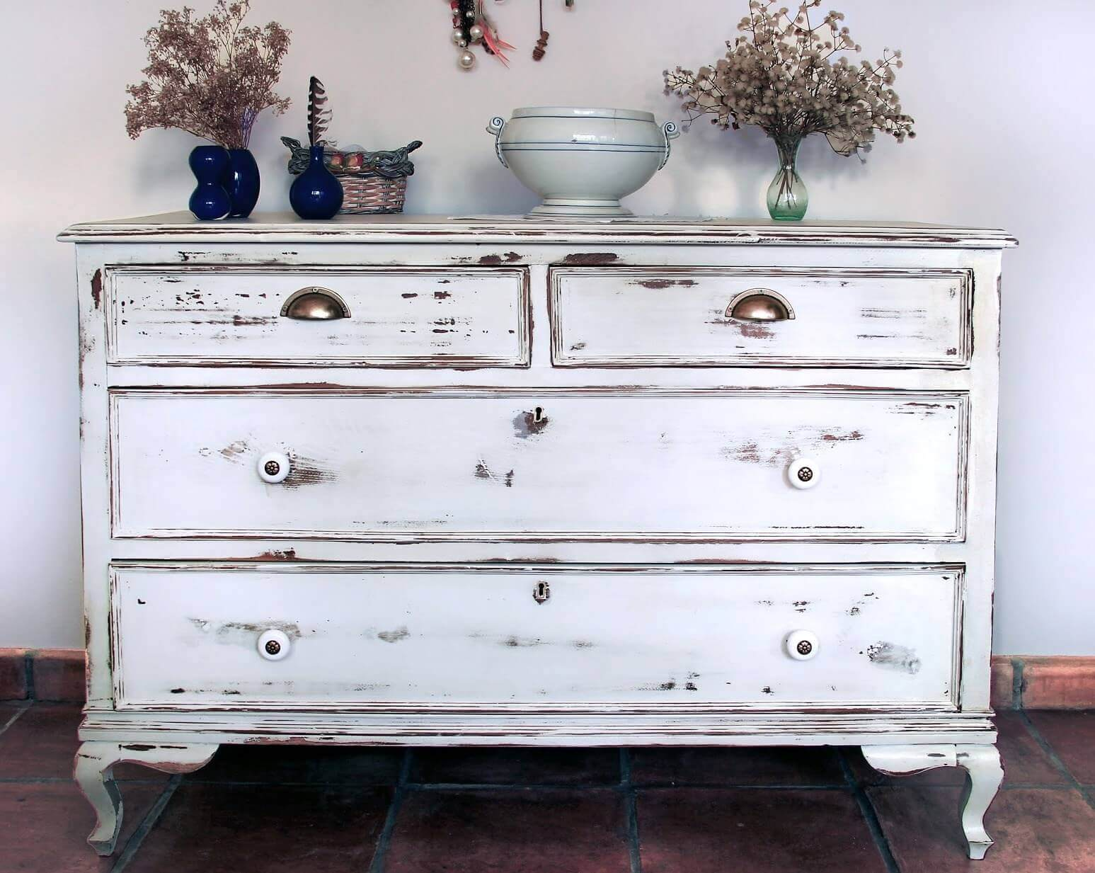 Age Your Wooden Furniture With A Distressed Paint Effect