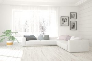 Whitish wood floor in a living room.