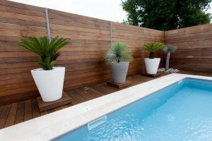 A wooden deck for a pool.