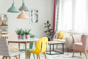A room with blue green and pastel pink decor pairings.