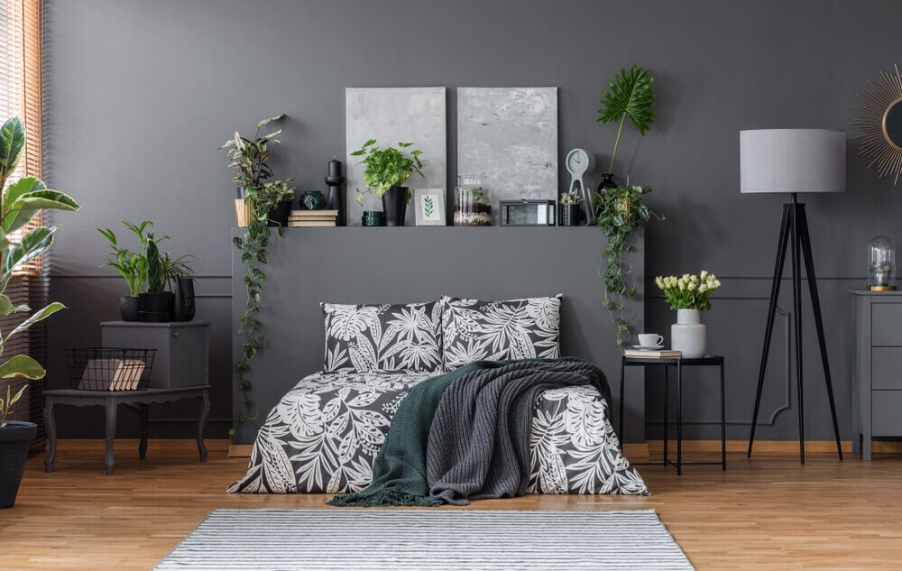 A bedroom with lots of dark gray.