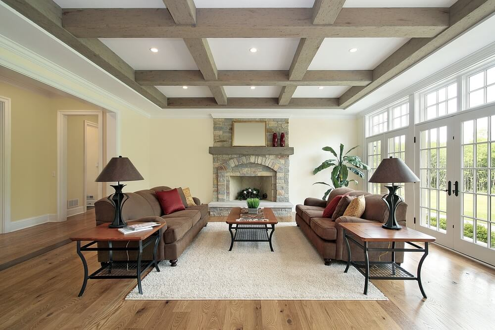 A living room with exposed beams in the ceiling.