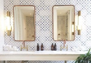 Glass mirrors with gold borders.