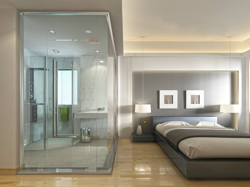 A stylish gray toned bedroom with an inset bathroom