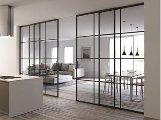 A classy glass wall including a sliding door to divide the kitchen and dining/living room