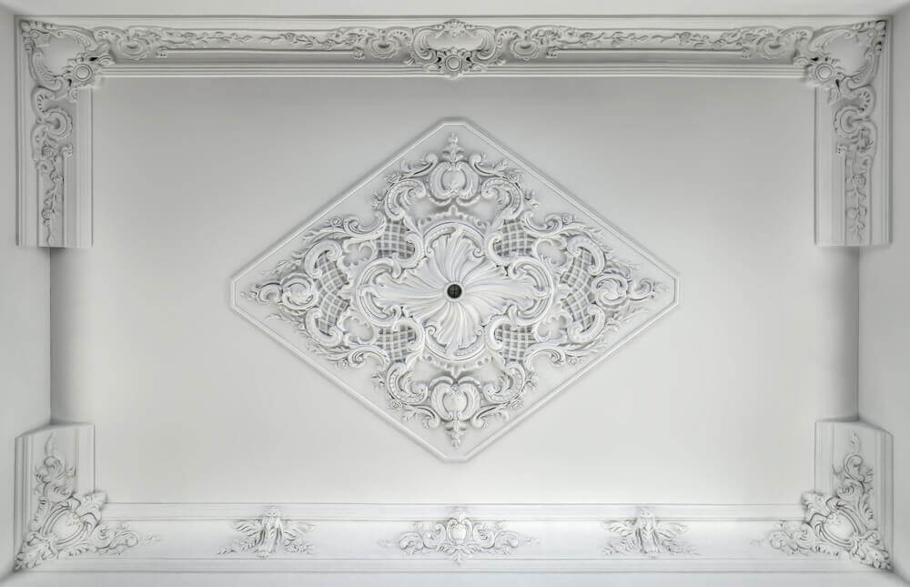 A ceiling with intricate moldings.