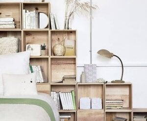 A bedroom with wooden shelving.