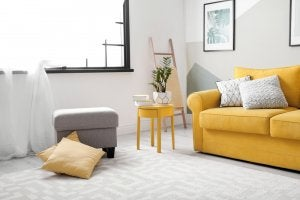 A yellow couch with wood around it.