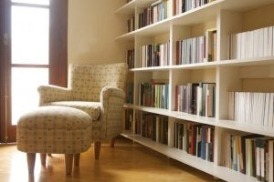 An armchair in a library.