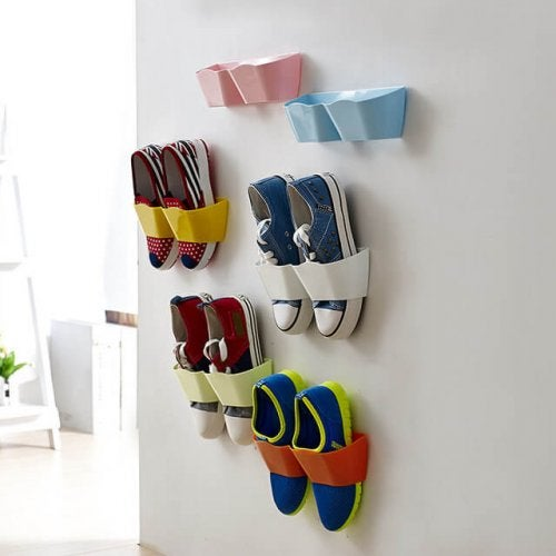A few pairs of hanging shoes.