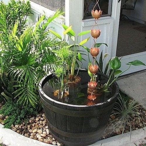 A rain chain that goes into a pot.