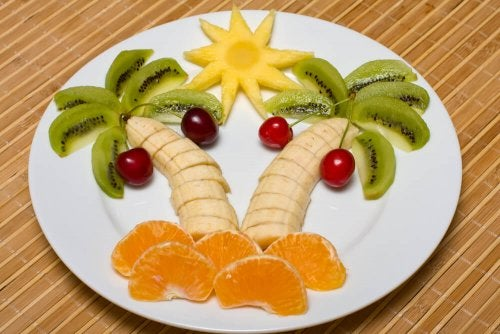 A tropical scene made with fruit.