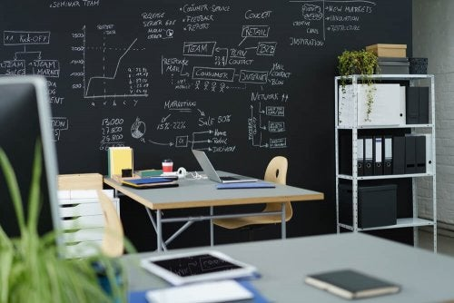 An office with a black wall.