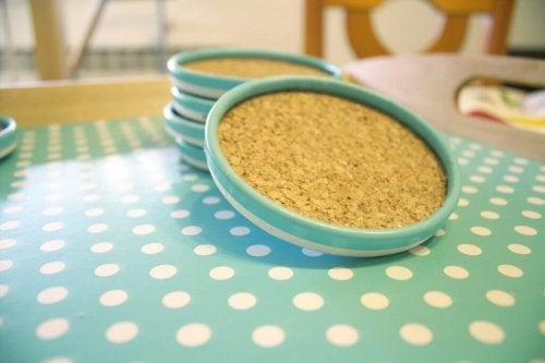 Drink coasters made with lids and cork.