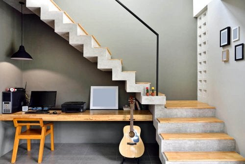 A desk in the space under the stairs.