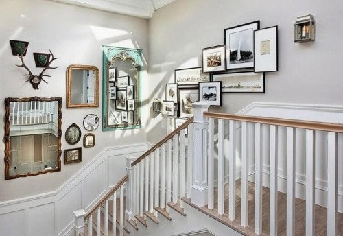 A collection of photos on the wall facing the staircase.