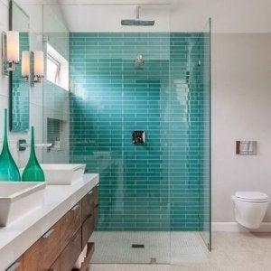 Turquoise shower tiles.