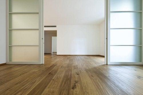 An empty apartment with sliding doors.