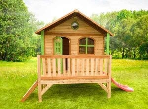 A wooden playhouse with slide and patio.