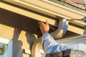 Installing rain gutters.