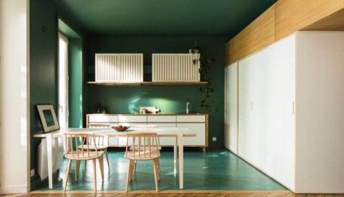 A kitchen with bottle green ceiling, walls, and floor.