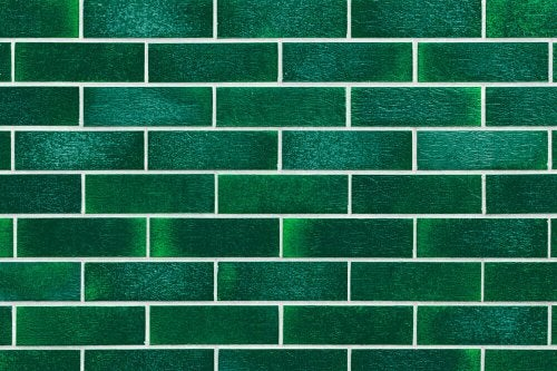 A green tile wall.