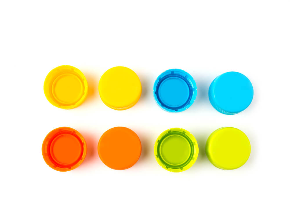 Brightly colored plastic bottle lids