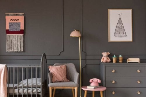 A gray kid's bedroom with a pale pink accent color