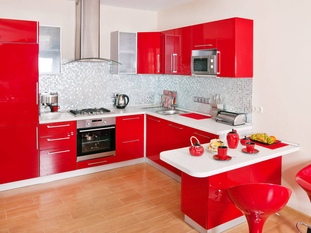 Red cupboards with white bench tops