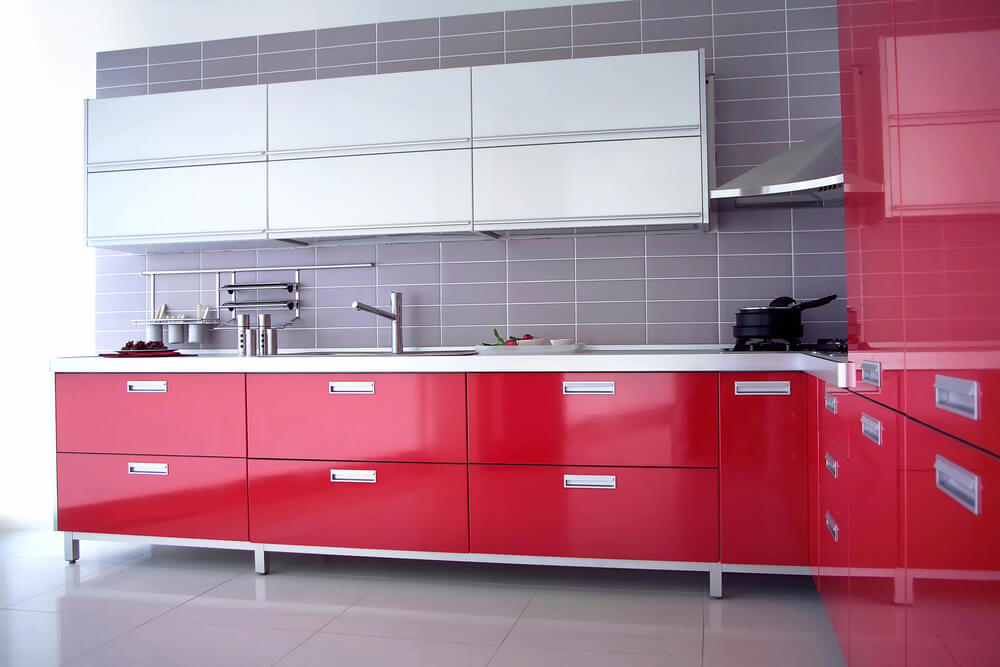 A contrast between scarlet drawers and gray tiled walls