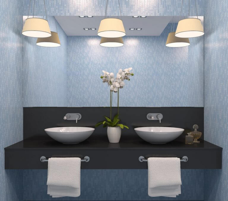 Hanging lights at the mirror in the bathroom