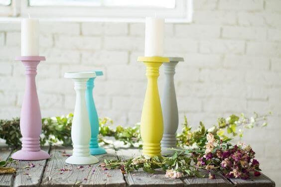 Colorful candle stick holders decorating a rustic table