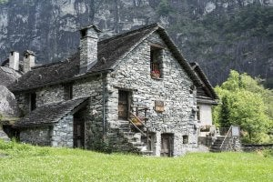 Country houses are often made out of materials such as stone.
