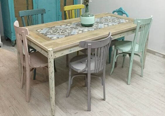 Dining chairs in pastel colors with a rustic timber table