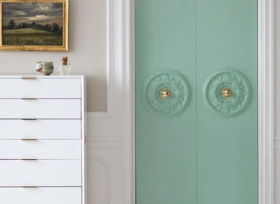 Pastel teal doors with art deco trim