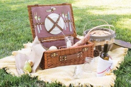 A wicker basket on top of a beige blanket.