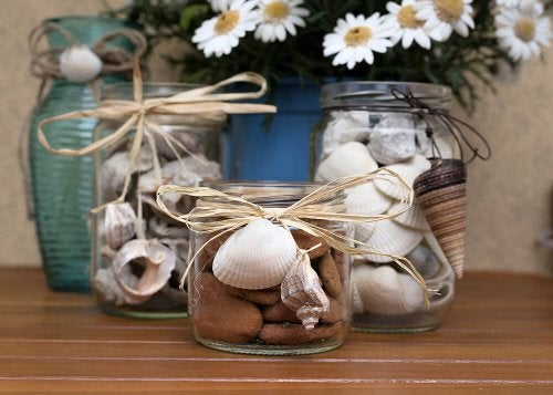Glass jars with seashells and conches.