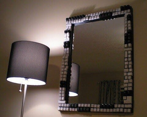 A mirror frame decorated with black and white keyboard keys.