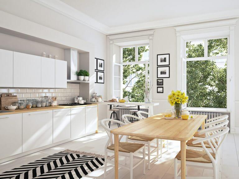 An airy open plan kitchen design with a dining area included