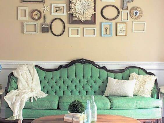 An antique sofa repainted using pale green chalk paint